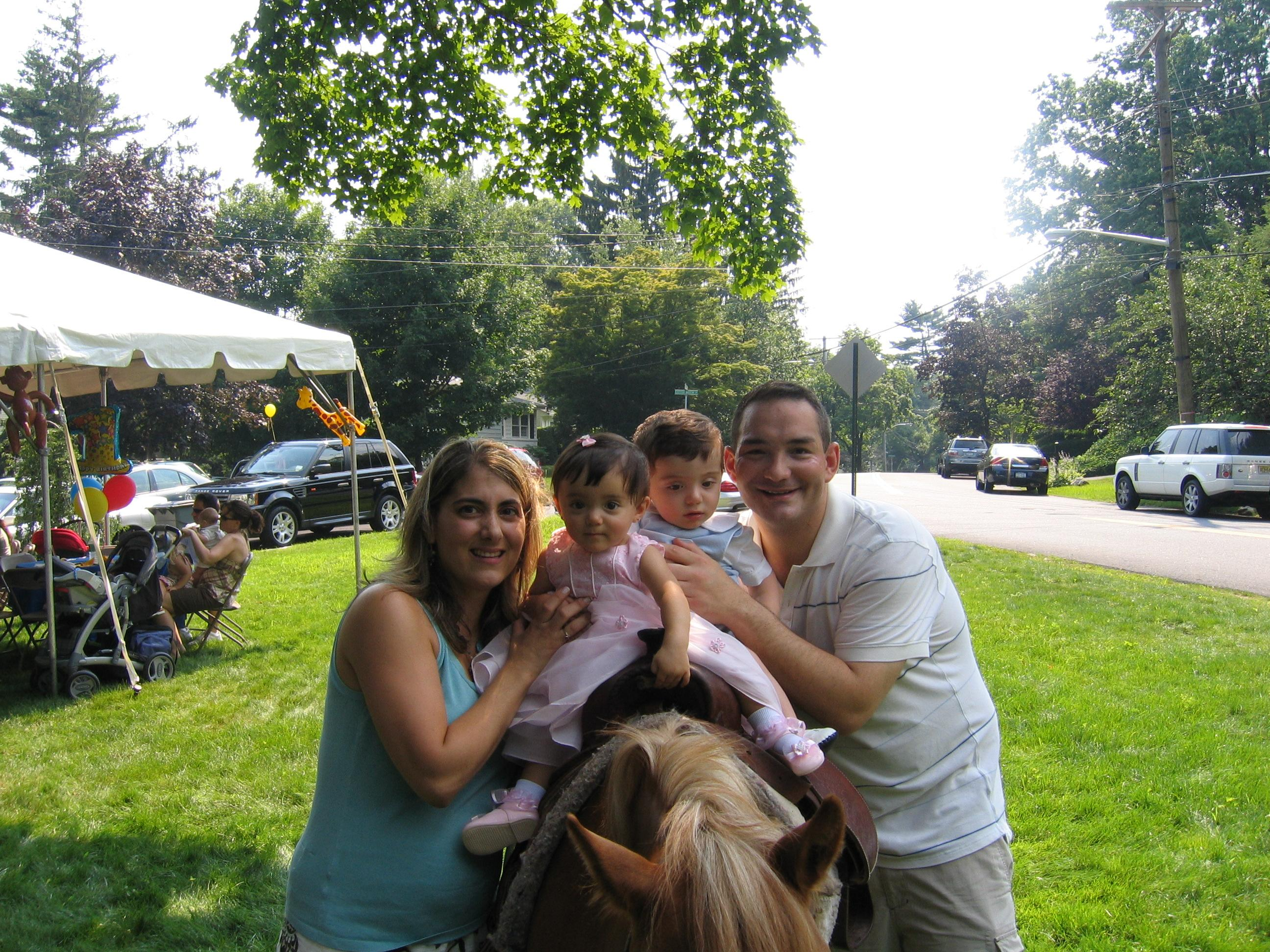 Mommy & Daddy with us on our pony ride at our 1st B.Day Party!